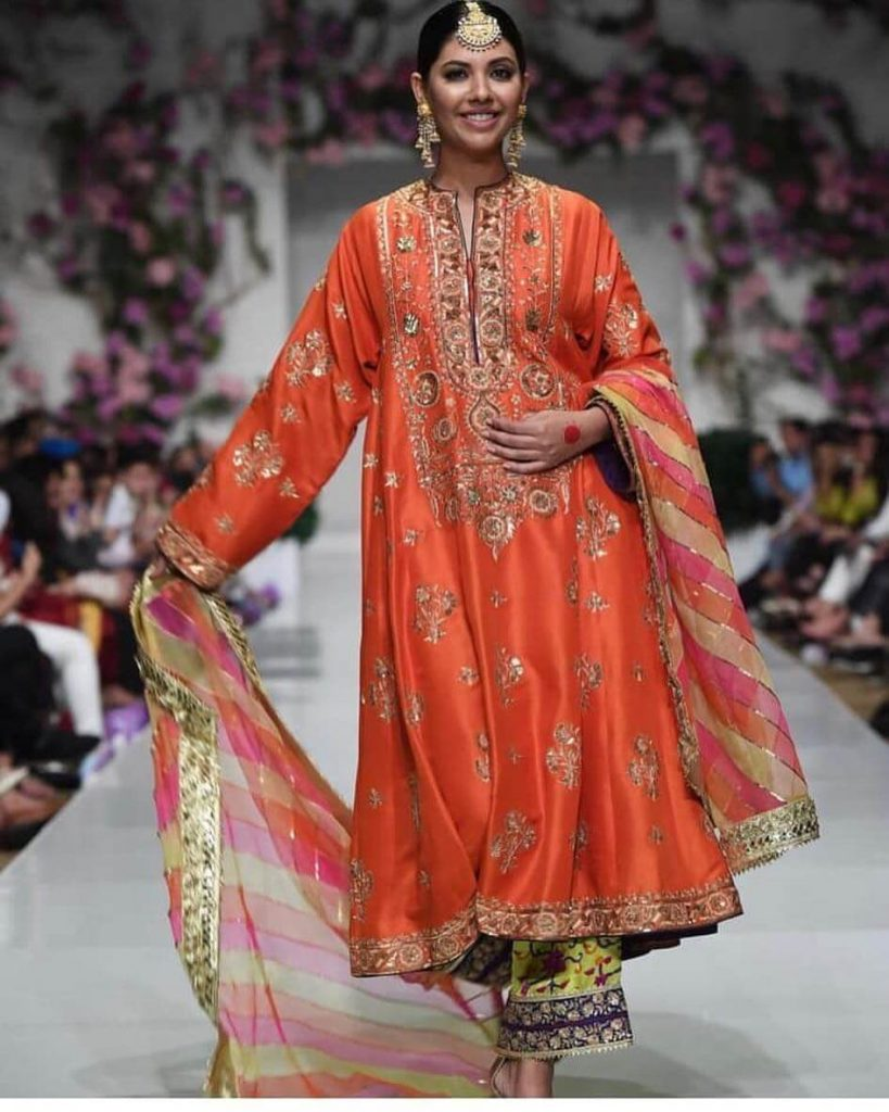 Sunita Marshall orange dress